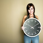Woman holding wall clock