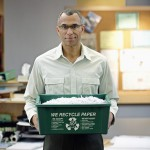 Businessman Holding Recycling Bin