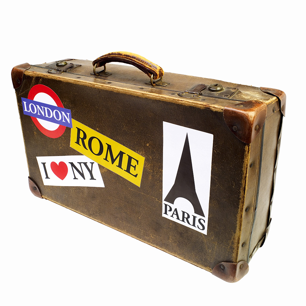 Close up of a suitcase covered with travel stickers